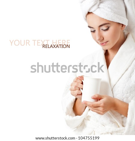 beautiful woman wearing bathrobe holding white mug, copy space for text