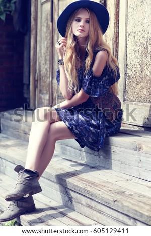 Beautiful woman wearing boho chic clothes. Outdoor fashion portrait
