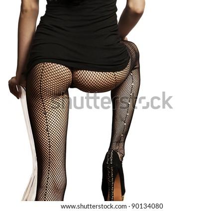 Beautiful woman wearing fishnet stockings