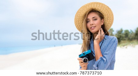 Beautiful woman wearing hat and shorts white beach,Minimal style and pastel tone.copy space,spring,summer,travel tips,planing,flight