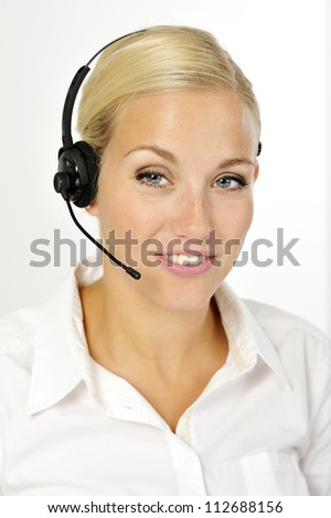 Beautiful woman wearing headset and white blouse.  Focus on the eyes and tooth.