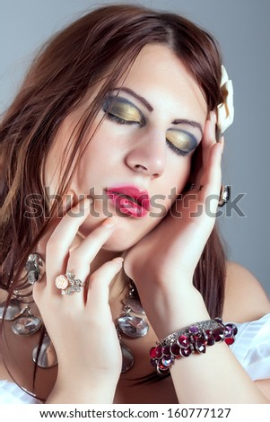 beautiful woman wearing necklace and rings