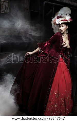 Beautiful woman wearing red dress over a train