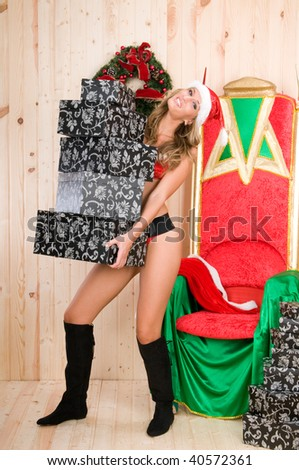 beautiful woman wearing santa claus clothes with presents