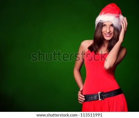 Beautiful woman wearing Santa Claus hat smiling to camera
