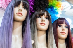 Beautiful woman wig Put them in a row on the shelves in the wig shop.