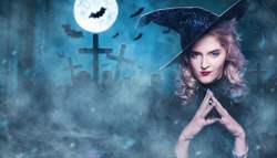 Beautiful woman witch in the cemetery. Halloween, costume for a party.