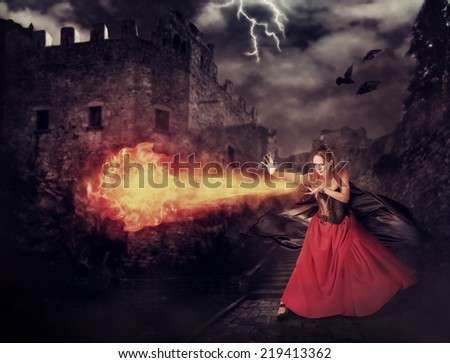 beautiful woman witch trains in medieval castle cast magic - fireball
