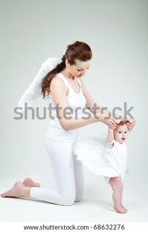 Beautiful woman with a baby angel angel