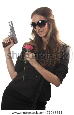 Beautiful woman with a gun and rose