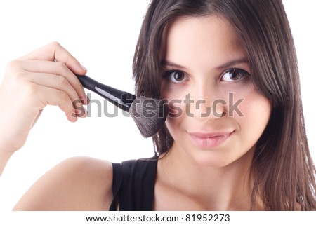 Beautiful woman with a make-up brush