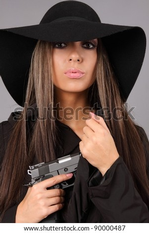 Beautiful woman with a pistol.