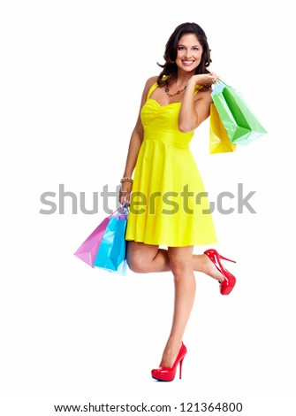 Beautiful woman with a shopping bags. Isolated on white.