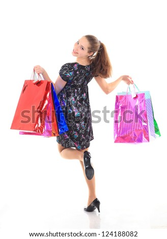 Beautiful woman with a shopping bags. Isolated on white. #124188082