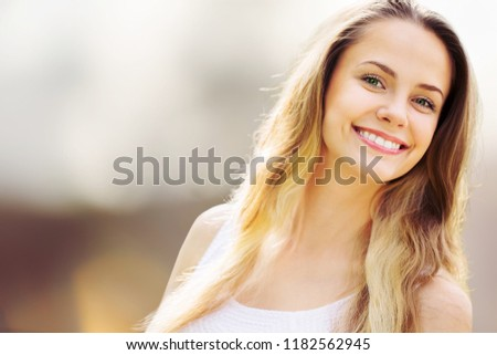 Beautiful woman with a whiten perfect smile #1182562945