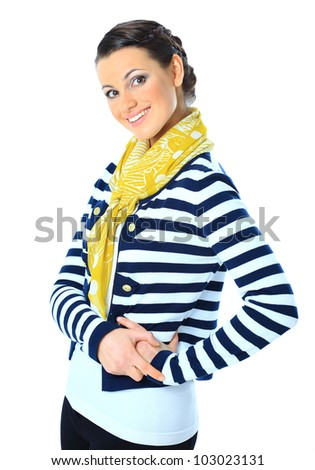 Beautiful woman with a yellow scarf, hands on hips. Isolated on a white background.