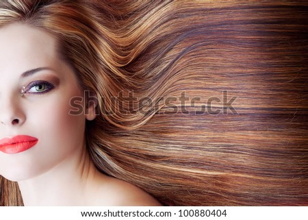 beautiful woman with artistic makeup and long brown shiny hair background