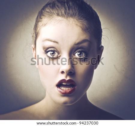 Beautiful woman with astonished expression