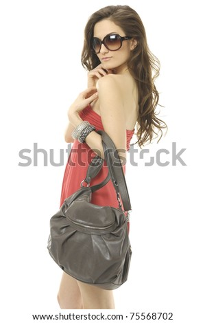 Beautiful woman with bag in short jeans - stock photo