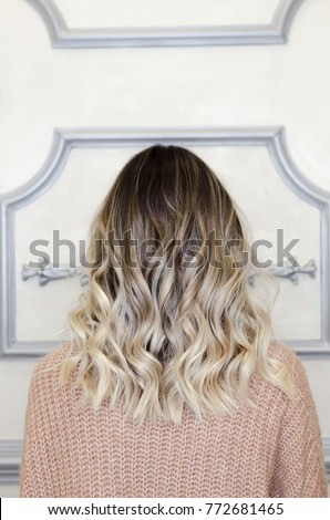 Beautiful woman with balayage hairstyle back view. Lovely modern and fashion hairstyles. Curly short or long hair. Space for text Photo stock ©