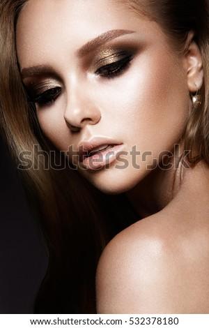 Shutterstock Beautiful woman with beautiful gold make up
