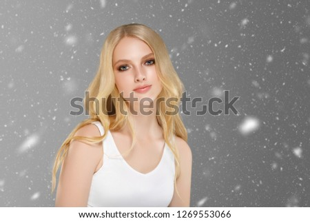 Beautiful woman with beauty hair with winter snow background xmas concept