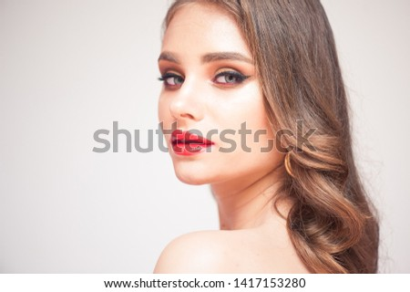 Beautiful Woman With Beauty Makeup On Face, Red Lipstick On Lips And Glamourous Look