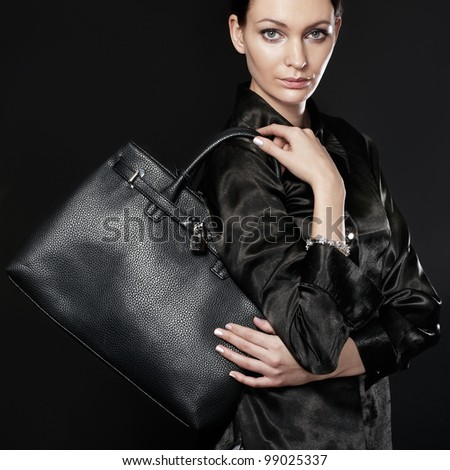 Beautiful woman with black bag