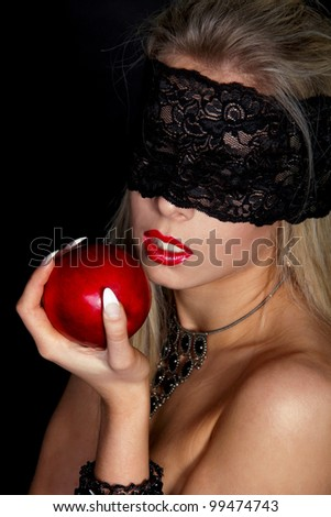 Beautiful Woman with Black lace eating Red apple isolated on black