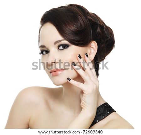 beautiful woman with black nails and bright eye make-up - on white background