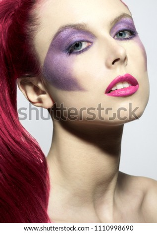 Stock Photo beautiful woman with blue eyes bright red hair purple eyeshadow with red lips