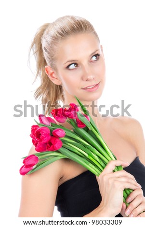 Beautiful woman with bouquet of red tulips flowers smiling and looking at the corner isolated on white background