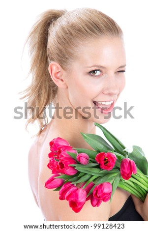 Beautiful woman with bouquet of red tulips flowers smiling, winks and looking at the corner isolated on white background