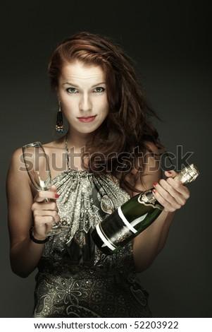Beautiful woman with ?champagne - stock photo