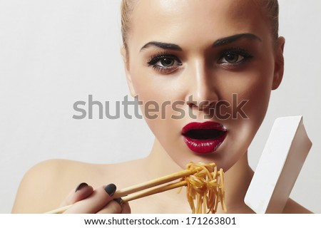 Beautiful Woman with Chinese Noodles.Red Lips.Sticks. Fast Food Delivery. Enjoy meal
