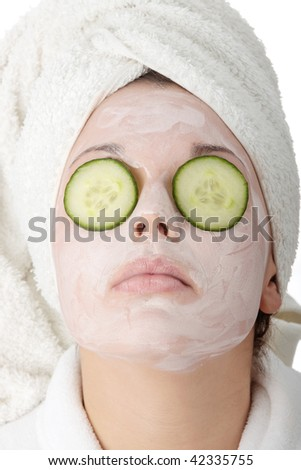 Beautiful woman with clay mask isolated