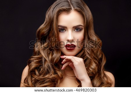 Beautiful Woman with Clean Fresh Skin and healthy curly hair #469820303