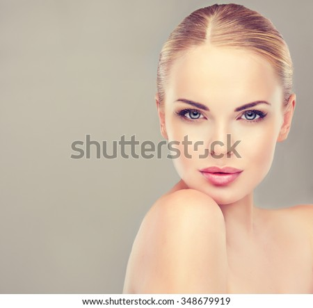Stock Photo Beautiful  Woman with Clean Fresh Skin close up . Skin care face . Cosmetology