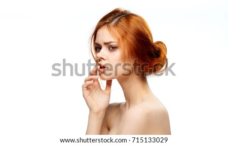 beautiful woman with clean skin of the face on an isolated background portrait                                #715133029