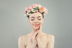Beautiful woman with clear skin, flowers and manicure nails relaxing. Skin care, facial treatment and relaxation concept
