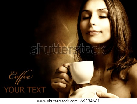 Beautiful Woman With Coffee.Isolated on black.Copy-space