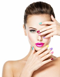 Beautiful woman  with colored nails and pink lips. Attractive stylish fashion model