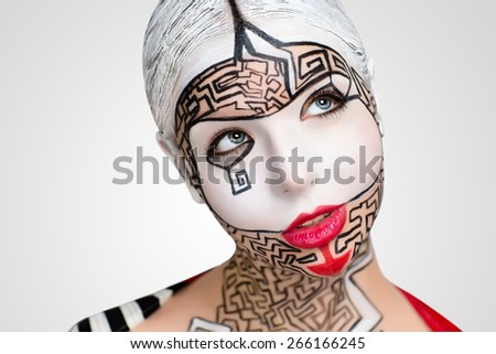Beautiful woman with conceptual art makeup, big white picture on face, red lips, black lines of maze puzzle, close up new portrait. Photo with big free space, area, place for text inscription, buttons