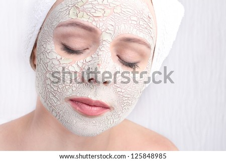 Beautiful Woman With Cosmetic Clay Mask on Face face.