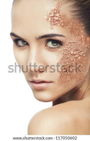 beautiful woman with cracked powder on white background