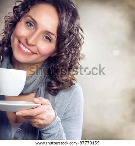 Beautiful Woman With Cup of Tea or Coffee - stock photo