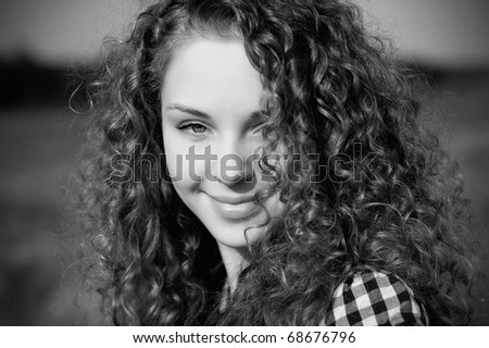 beautiful woman with curly hair and playful look
