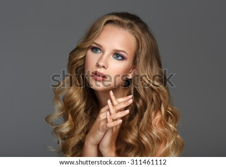 Beautiful Woman with Curly Long Hair. Color makeup.
