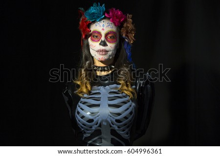 beautiful woman with custom designed candy skull mexican day of the dead face make up Stock photo ©