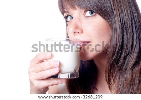 Beautiful woman with drinking milk from glass